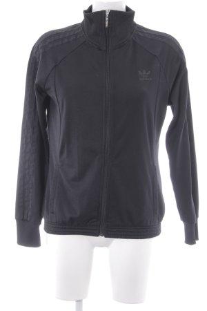 Adidas Sportjacke schwarz Streifenmuster sportlicher Stil