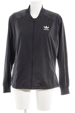 Adidas Sportjacke schwarz-weiß Streifenmuster Glanz-Optik