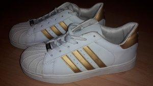 Adidas Superstar Gr. 38 (fällt kleiner aus!). Kein Original