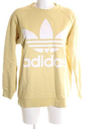Adidas Sweatshirt blassgelb Schriftzug gedruckt Casual-Look
