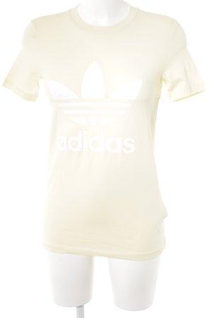 Adidas T-Shirt blassgelb-weiß Schriftzug gedruckt Street-Fashion-Look