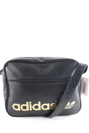Adidas Umhängetasche schwarz-goldfarben Schriftzug gedruckt sportlicher Stil