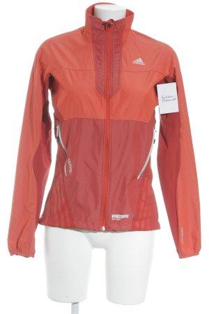 Adidas Giacca a vento rosso-rosso chiaro stile atletico