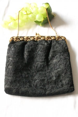 Minibolso negro-color oro