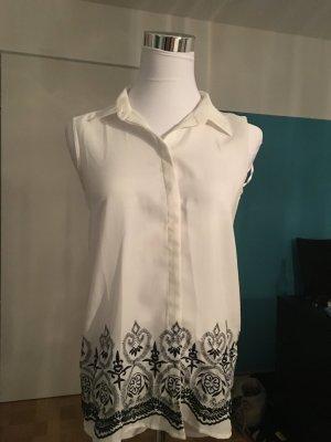 Ärmellose Bluse in naturweiß mit schwarzer geblümter Stickerei, Esprit, 34