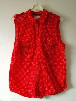 Ärmellose Bluse in Rot mit weißen Punkten