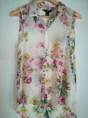 Ärmellose Bluse mit Blütenmuster.