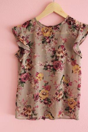Ärmellose Bluse mit Blumenmuster