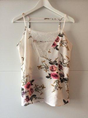 Ärmellose Bluse mit Blumenmuster, Größe 36