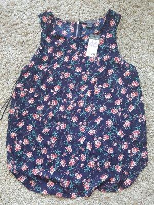 Ärmellose Bluse mit Reißverschluss und Blumenmuster
