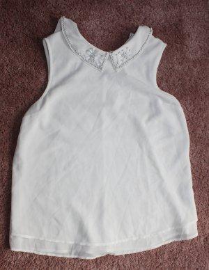 Ärmellose Bluse mit Verzierung am Hals