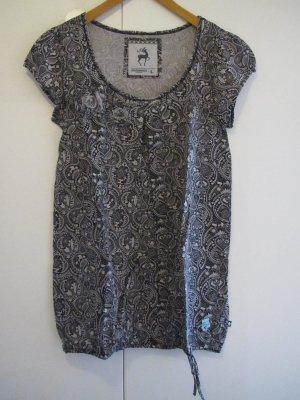 Alprausch – Schwarz-beiges T-Shirt mit Blumenapplikation
