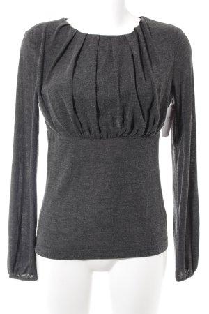 Ana Alcazar Camisa larga gris look casual