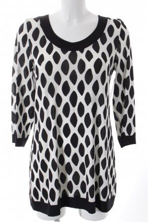 Anja Gockel Lange blouse zwart-wit gestippeld patroon straat-mode uitstraling