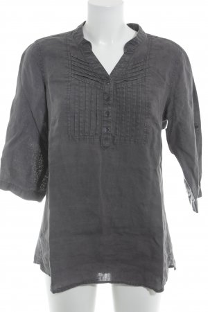 Anne L. Blusa de manga larga gris look casual
