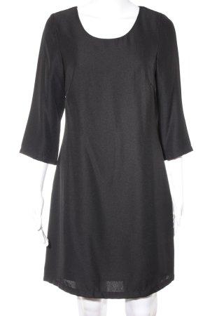 Anne L. Jurk met lange mouwen zwart elegant