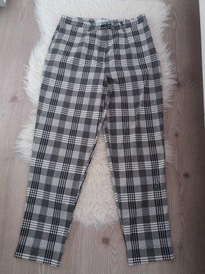 Pantalone peg-top bianco-nero