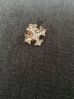 Broche color oro-blanco