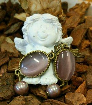 Antik-bronze-farbene Ohrhänger mit lila Cabochons