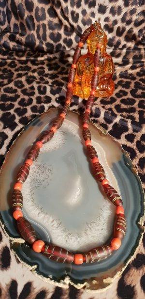 Collar de perlas naranja-coñac