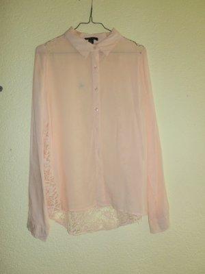 Apricot-farbene Bluse mit Spitze am Rücken
