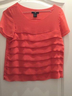 Apricotfarbene Bluse in Größe 34