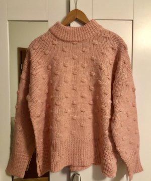 Aprikot/ rosa Pullover mit Bommeln