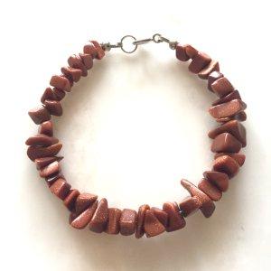 Armband aus braunen schimmernden Steinen NEU