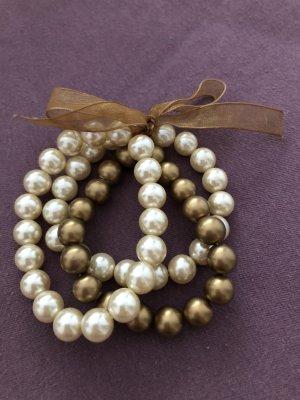 Armband bestehend aus drei Perlenarmbändern gold/weiß