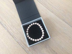 Armband mit rosafarbenen Muschelkern-Perlen