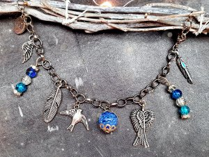 Armband silber blau Perle Charm handmade Unikat Reisen Vogel
