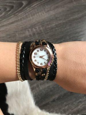 Reloj con pulsera de cuero negro-color oro