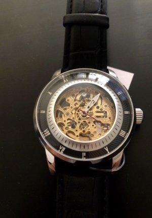 Armbanduhr mit skelettiertem Zifferblatt vergoldet