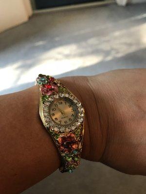 Armbanduhr/Spangenuhr goldfarben/bunt mit Blütenmotiven und weissen und farbigen Kristallen
