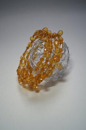 Armreif, Spiralarmband, Memoryarmband Orangetöne Bernsteinfarben von Dawanda