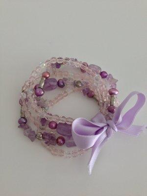 Armdecoratie roze-lila