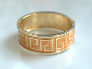 Brazalete naranja claro-color oro