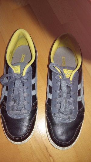 Asics Sneaker schwarzes Leder grauer Streifen, gelber Rand