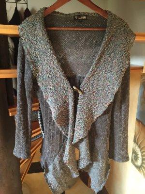 Asymmetrische Jacke mit besonderem Materialmix