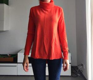 Asymmetrischer Orangener Rollkragenpullover
