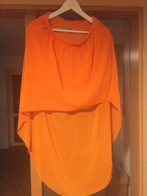 Asymmetrischer Vollantrock im sommerlichen orange