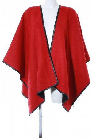 Atelier Poncho rojo-negro look casual