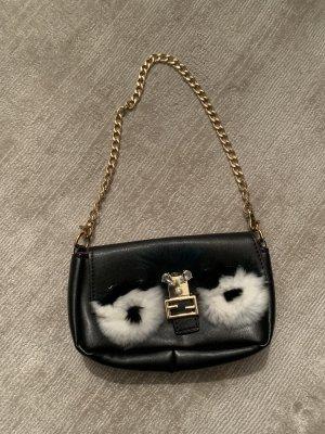 Auffällige Tasche mit Augen aus Pelz