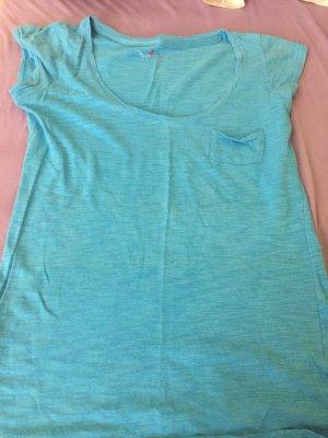 Auffälliges blaues Tshirt