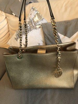 Ausgefallene Handtasche von Michael Kors in gold