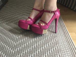 Ausgefallene high heels in pink gold