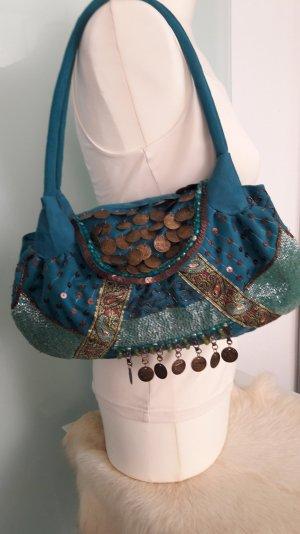 Ausgefallene reich dekorierte Handtasche