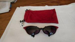 """Ausgefallene Sonnenbrille """"101 Dalmatiner"""" rot/schwarz von Alain Mikli"""