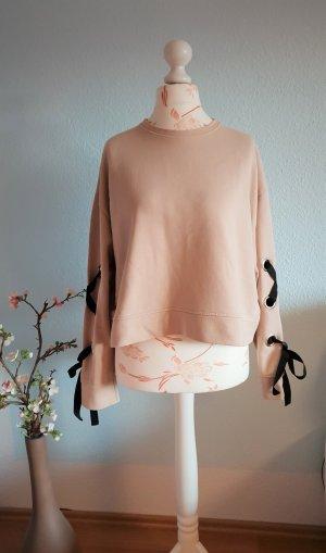 ausgefallener, beiger Sweater mit Schleifen an Ärmeln von Zara