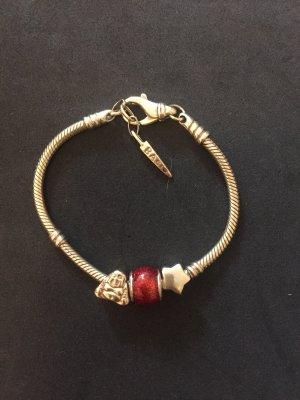 Ornamento braccia oro-rosso